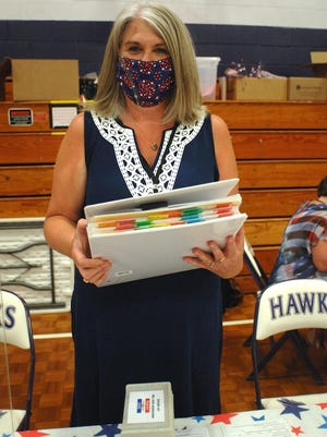 Eliot Town Clerk Wendy Rawski shows the binder full of absentee ballot applications during town election and Maine state primary voting on Tuesday, July 14. Rawski said absentee ballot applications were way up, from the usual 300 to 400 to more than 1,600.