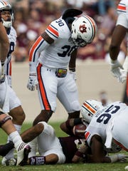 Auburn linebacker Tre' Williams (30) reacts after stopping Texas A&M running back Trayveon Williams (5) on a run during the first half of an NCAA college football game on Saturday, Nov. 4, 2017, in College Station, Texas. (AP Photo/Sam Craft)
