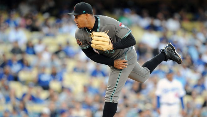 April 14, 2018; Los Angeles, CA, USA; Arizona Diamondbacks starting pitcher Taijuan Walker (99) throws against the Los Angeles Dodgers during the first inning at Dodger Stadium. Mandatory Credit: Gary A. Vasquez-USA TODAY Sports