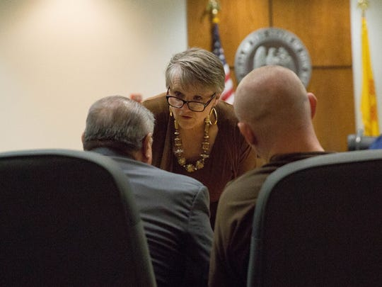 Liane Kerr speaks with Mario Esparza, left, and her client Jesse Hanes, right, during a change-in-venue hearing, Wednesday, April 12, 2017.