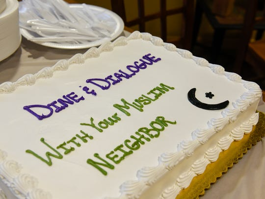A cake is ready for guests during a Dine and Dialogue