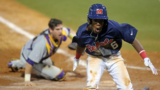 Shortstop Errol Robinson celebrates after scoring a run against LSU. The junior was drafted in the MLB Draft on Friday.