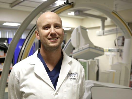 Neurosurgeon Dr. Adam Oliver poses in the catheterization