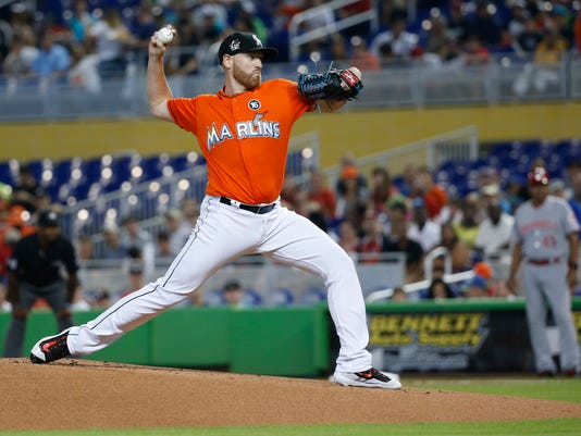 Miami Marlins' Dan Straily delivers a pitch during the first inning of a baseball game against the Cincinnati Reds, Sunday, July 30, 2017, in Miami. (AP Photo/Wilfredo Lee)