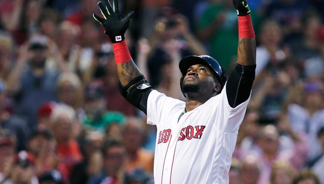 Boston Red Sox designated hitter David Ortiz raises his arms as he crosses home plate on his three-run home run off Detroit Tigers starting pitcher Mike Pelfrey during the third inning of a baseball game at Fenway Park, Tuesday, July 26, 2016, in Boston.