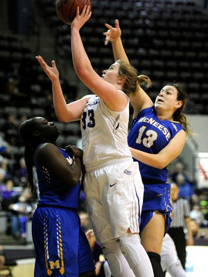 Abilene Christian's Sydney Shelstead (33) puts up a shot over McNeese State defenders during the fourth quarter of the Wildcats' 77-65 win on Saturday, Jan. 28, 2017, at ACU's Moody Coliseum.