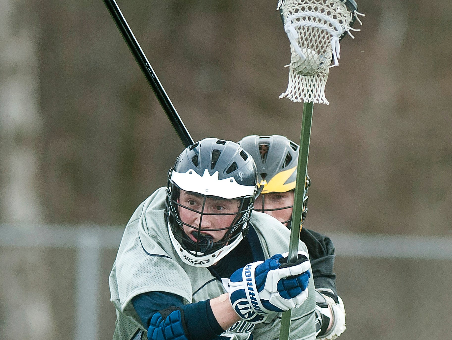 Burlington sophomore defenseman Alex Cate tries to carry the ball past a Harwood defender during Friday's game at Buck Hard Field.