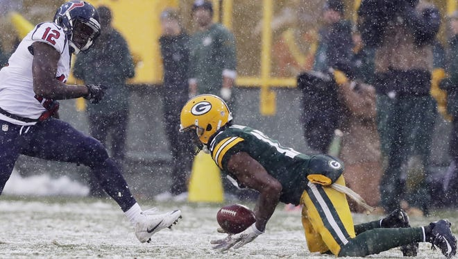 Green Bay Packers wide receiver Davante Adams (17) recovers an onside kick against Houston Texans wide receiver Keith Mumphery (12) late in the fourth quarter as the Green Bay Packers host the Houston Texans on Sunday, December 4, 2016, at Lambeau Field in Green Bay, Wis. The Packers defeated the Texans 21-13. Adam Wesley/USA TODAY NETWORK-Wisconsin