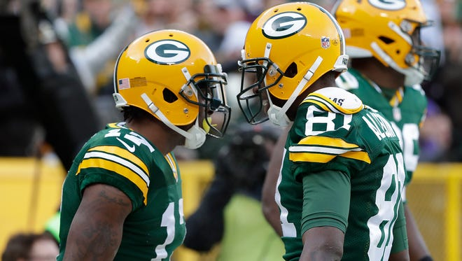 Green Bay Packers wide receiver Davante Adams (17) celebrates his touchdown with wide receiver Geronimo Allison (81) in the first quarter against the Minnesota Vikings at Lambeau Field Saturday, December 24, 2016.