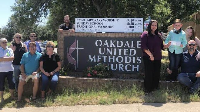 Paxton Ables (far right) is pictured holding a donation check with Julie Howell, president of Backpack Buddies of Erath County, and standing next to his parents, Michael and Kelly Ables. Also pictured are other members of Backpack Buddies and pastor, Kory Koch of Oakdale United Methodist Church.