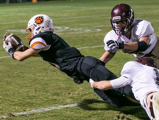 MTCS' Josh Letzler stretches for yardage against the
