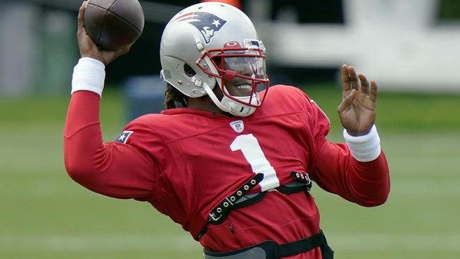New England Patriots quarterback Cam Newton throws during an NFL football training camp practice, Monday, Aug. 17, 2020, in Foxborough, Mass.