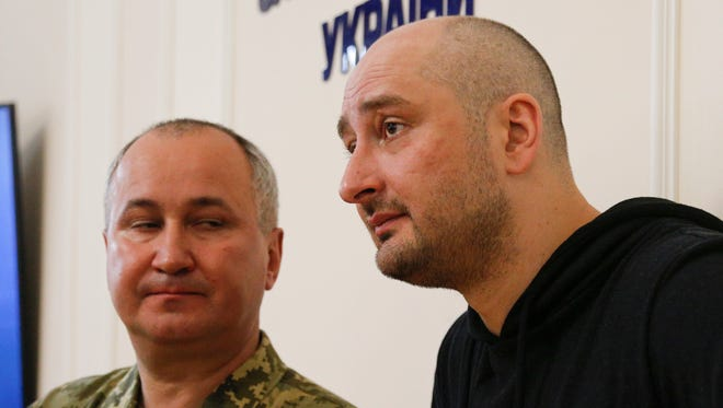 Russian journalist Arkady Babchenko, right, and Vasily Gritsak, head of the Ukrainian Security Service speak at an SBU news conference on May 30, 2018 in Kiev.. Babchenko showed up one day after he had purportedly been killed in a police ruse to try to catch a person who ordered him shot. .