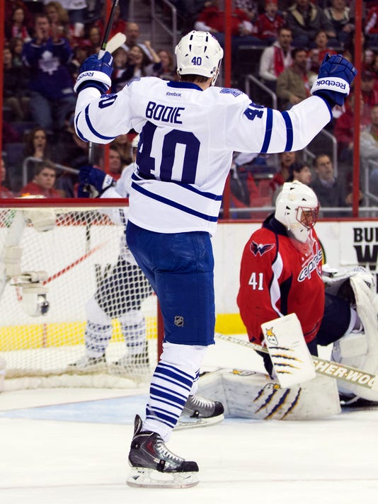 Toronto Maple Leafs right wing Troy Bodie (40) celebrates after scoring a goal past Washington Capitals goalie Jaroslav Halak (41) during the first period of an NHL hockey game on Sunday, March 16, 2014, in Washington. (AP Photo/ Evan Vucci)