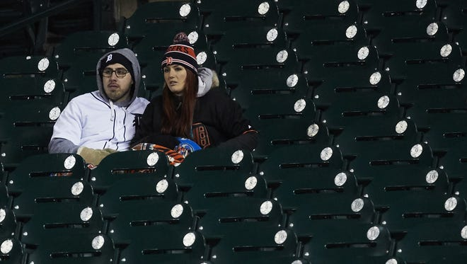 Apr 17, 2018; Detroit, MI, USA; Fans bundle up in blankets in the right field bleachers during the eighth inning of the game between the Detroit Tigers and the Baltimore Orioles at Comerica Park.