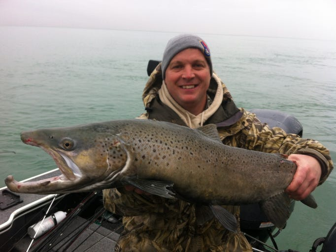 Kurt Schultz with a brown trout caught in Lake Michigan