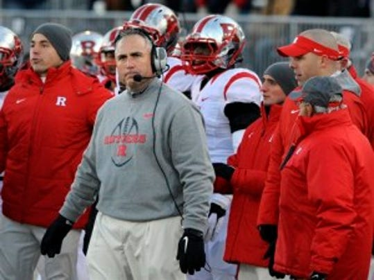 Rutgers coach Kyle Flood understands the benefits for both sides of a FBS vs. FCS game, but he also understands the value of strength of schedule under the new college football rules. (AP)