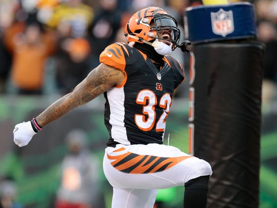 Cincinnati Bengals running back Jeremy Hill (32) celebrates a touchdown last season against Pittsburgh.