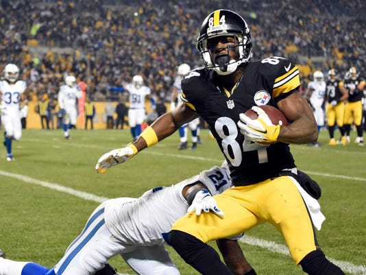 FILE - In this Dec. 6, 2015, file photo, Pittsburgh Steelers wide receiver Antonio Brown (84) catches a touchdown pass from quarterback Ben Roethlisberger as Indianapolis Colts cornerback Vontae Davis (21) defends during the first half of an NFL football game in Pittsburgh. Roethlisberger and Brown have masterfully dissected the Colts' secondary, turning potentially competitive games into blowouts.  (AP Photo/Fred Vuich, File)