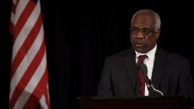 Supreme Court Justice Clarence Thomas speaks at the memorial service for Justice Antonin Scalia in Washington on March 1, 2016.