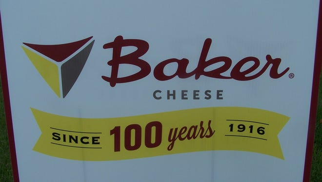 Signs proclaiming the 100th anniversary of Baker Cheese greeted the approximately 500 attendees at a celebration on Sept. 17.