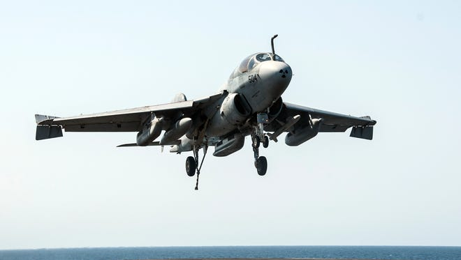 In this image provided by the U.S. Navy a EA-6B Prowler attached to the Garudas of Electronic Attack Squadron (VAQ) 134 lands aboard the aircraft carrier USS George H.W. Bush after conducting strike missions Tuesday, Sept. 23, 2014, against Islamic State group targets in Syria. (AP Photo/U.S. Navy, Mass Communication Spc. 3rd Class Brian Stephens)