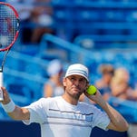 Mardy Fish (USA) acknowledges the crowd as he warms up prior to the match against Viktor Troicki (not pictured) on day three during the Western and Southern Open tennis tournament at Linder Family Tennis Center.