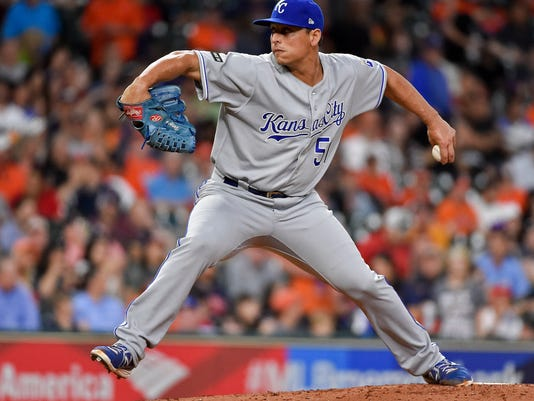 Kansas City Royals starting pitcher Jason Vargas delivers during the second inning of the team's baseball game against the Houston Astros, Friday, April 7, 2017, in Houston. (AP Photo/Eric Christian Smith)
