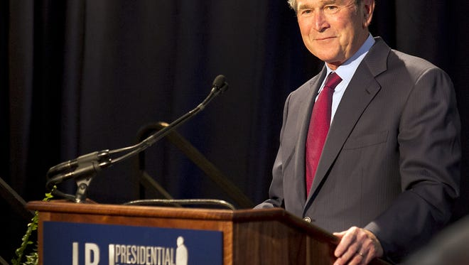 Former President George W. Bush addresses a private gathering in the LBJ Library Atrium on April 10, 2014 in Austin, Texas.