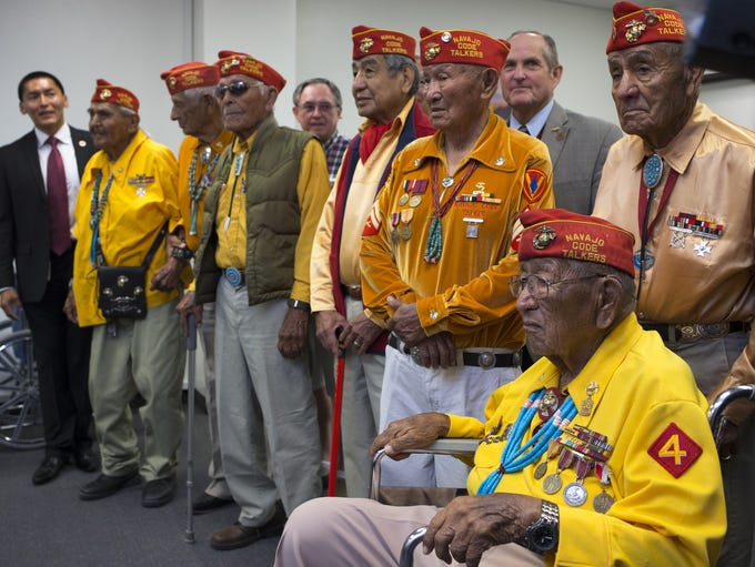 George James, third from right in the gold shirt, gathered
