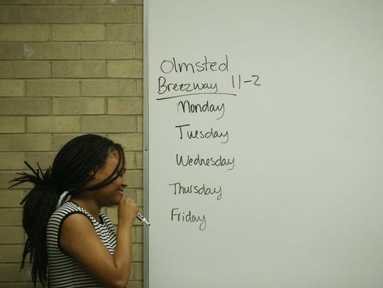 Drake student Brytani Cavil writes on the white board