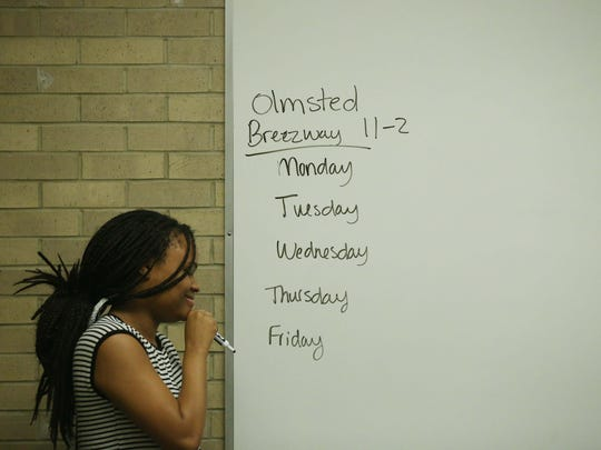 Drake student Brytani Cavil writes on the white board during Drake Professor Carol Spaulding-Kruse's class on Thursday, Feb. 18, 2016, on the Drake campus. The students in the class are helping produce a Unite Iowa series on race.