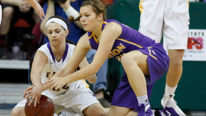 Clayton's Alison Leslie, right, battles with Barneveld's Mattie Schave for a loose ball during the first half of their WIAA Division 5 girls' state basketball semifinal at the Resch Center in Ashwaubenon.