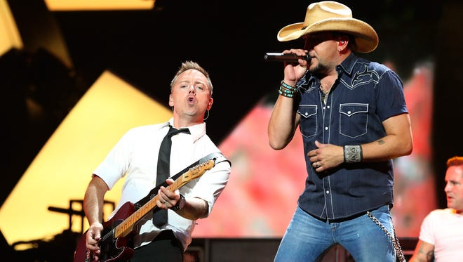 Recording artist Jason Aldean, right, and guitarist Kurt Allison perform onstage during the 2012 iHeartRadio Music Festival at the MGM Grand Garden Arena on Sept. 21, 2012 in Las Vegas, Nevada.