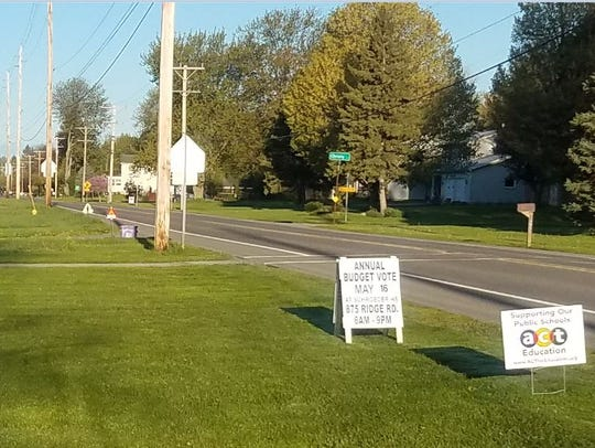 Signs outside State Road Elementary School in Webster.