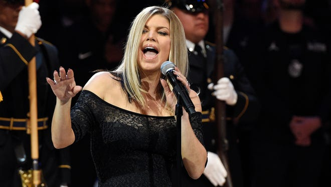 Fergie performs the national anthem prior to an NBA All-Star basketball game on Sunday, Feb. 18, 2018, in Los Angeles.