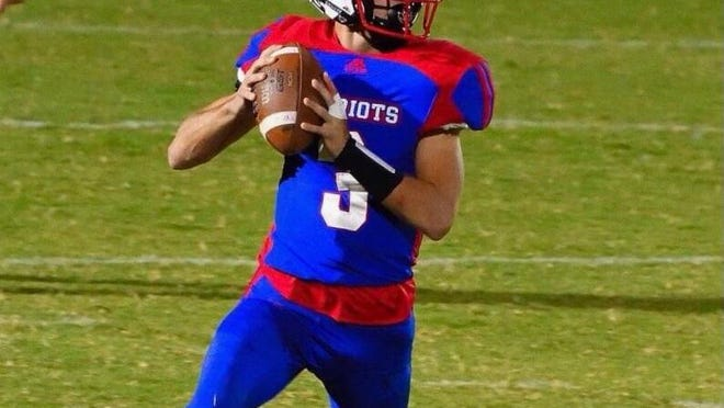 Oglethorpe County quarterback Will Sampson looks to pass during a game this season.