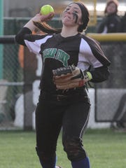 Clear Fork's Macy Wade throws the ball to first base