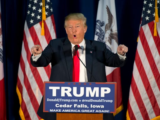 Republican presidential candidate Donald Trump points to the crowd while speaking at a rally Tuesday, in Cedar Falls, Iowa.