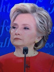 One of the three faces of Hillary-- the withering stare
