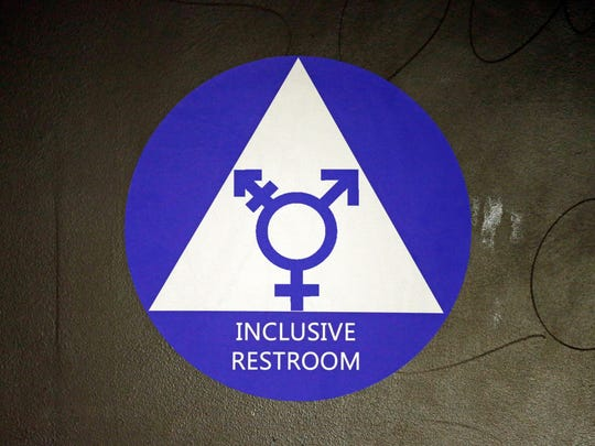 In this May 17, 2016, file photo, a sticker designates a gender-neutral bathroom at Nathan Hale High School in Seattle.