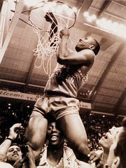 Wilie Worsley cuts down the net at the end of the game where Texas Western College (UTEP) defeated Kentucky in the 1966 NCAA Tournament.