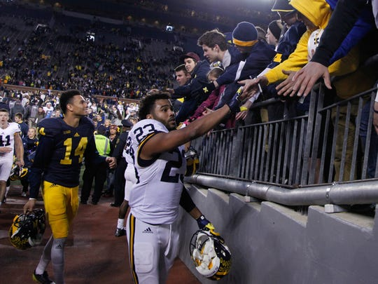 Michigan's Tyree Kinnel (23) signs autographs after U-M's 2016 spring game at Michigan Stadium.