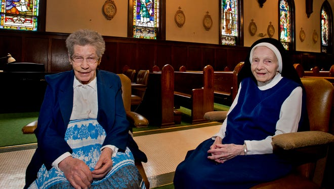 Sisters of Mercy Beatrice Couture, left, and Clare Naramore are turning 100 this year. Naramore's birthday is May 28, 2014, and Couture's birthday is June 27, 2014. They live at the convent in Burlington, Vt.