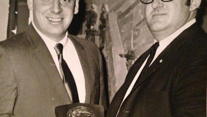 """Joseph R. Callo Jr., left, accepts the """"Police Officer of the Year"""" award from G. Alfred Mainettiin this Feb. 13, 1969 photo."""