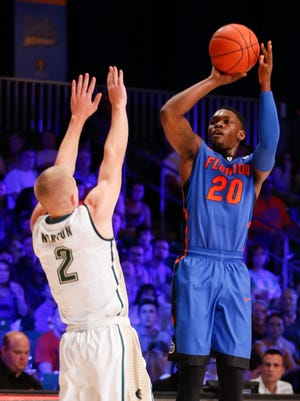 Florida guard Michael Frazier II shoots over UAB  guard Nick Norton at the Imperial Arena at Atlantis Resort.