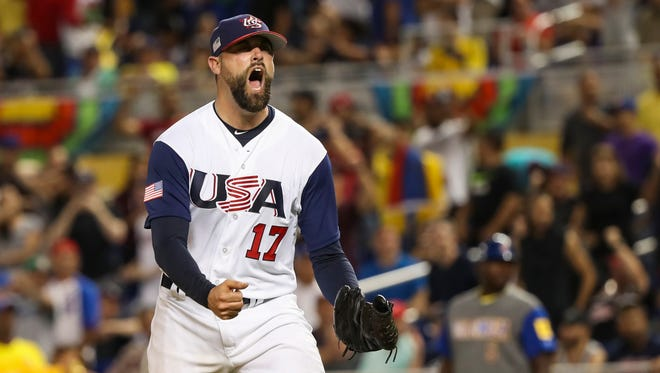 Pat Neshek exults after a double play ends the eighth inning, keeping Team USA tied with Colombia.