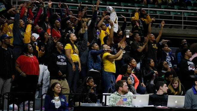 Detroit Henry Ford fans cheering late in Ford's 64-38 win over Cadillac in MHSAA Boys Class B semi final basketball game on Friday, March 27, 2015 in East Lansing.
