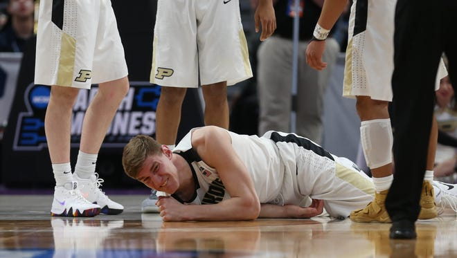 Purdue center Isaac Haas reacts after a foul by Cal State Fullerton forward Dominik Heinzi during the second half of the NCAA tournament Friday, March 16, 2018 at Little Caesars Arena.