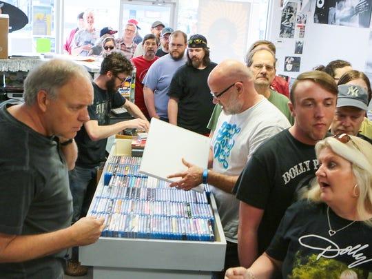 Rainbow Records founder Mark Hembree, left, helps customers